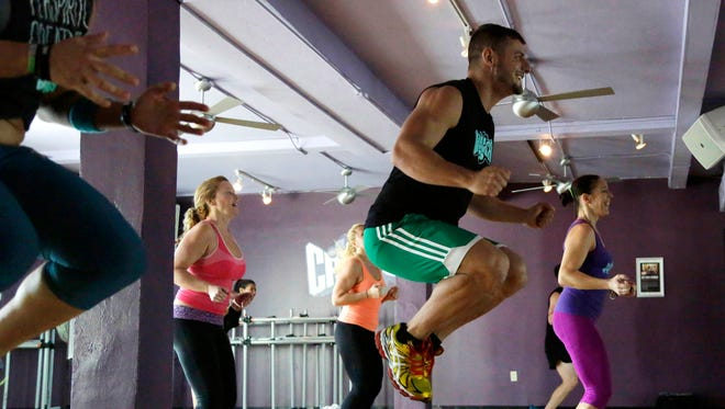 People take part in a Cutthroat Cardio class at a Crunch Gym in Miami Beach.