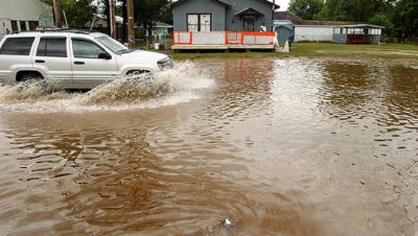 Flooding on Bernard Street in Carencro is shown in