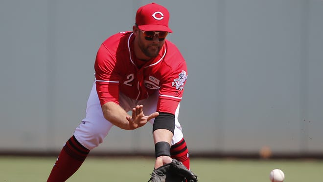 Cincinnati Reds shortstop Zack Cozart (2) fields a ground ball in the first inning during the National League baseball game between the Atlanta Braves and the Cincinnati Reds June 3 at Great American Ball Park.