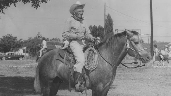 Red Smith waits to join the lineup in the annual Hill Country Rodeo parade in Junction in the 1960s.