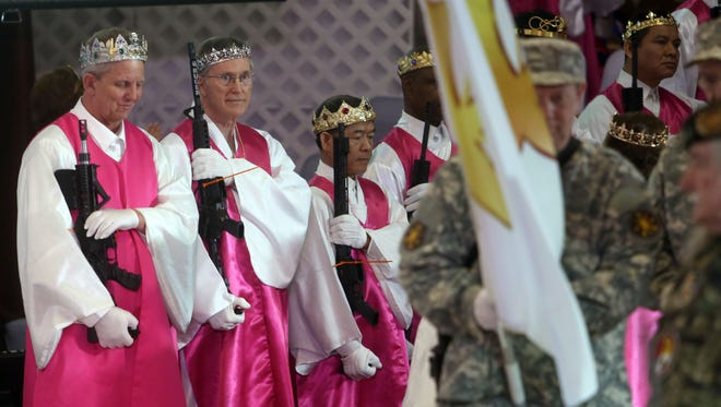 Men wear crowns and hold unloaded weapons at the World Peace and Unification Sanctuary Feb. 28, 2018 in Newfoundland, Pa.