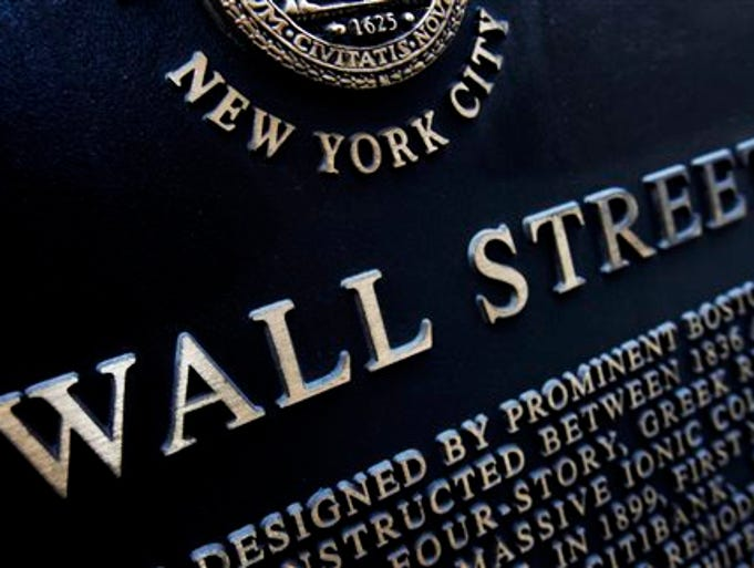 """This Jan. 4, 2010 file photo shows an historic marker on Wall Street in New York. Global stock markets were on course to end a solid week higher on Friday as investors continued to put their recent caution behind them amid further hopeful signs of an easing of tensions in Ukraine. David White, a trader at Spreadex, said, """"Investors still have confidence, but are now more price sensitive as capital becomes less cheap."""""""