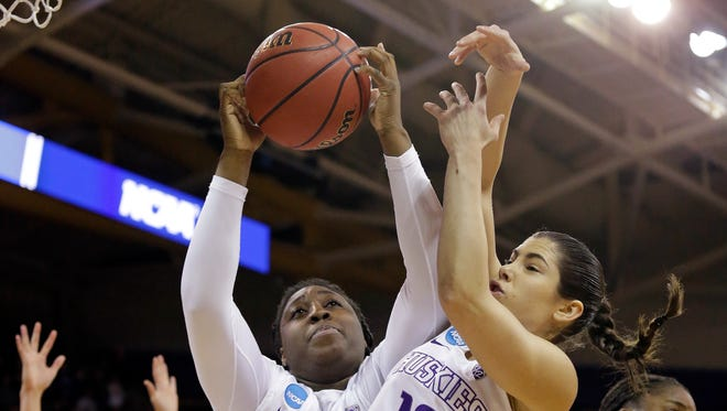 Washington's Chantel Osahor (center) grabs a rebound next to teammate Kelsey Plum in a 108-82 NCAA Tournament victory against Oklahoma on Monday.