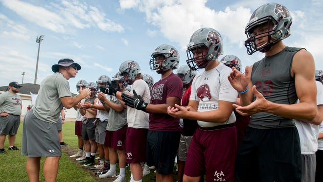 Alabama Christian head coach Nate Sanford works with players during football practice at the ACA campus in Montgomery, Ala. on Monday August 7, 2017.