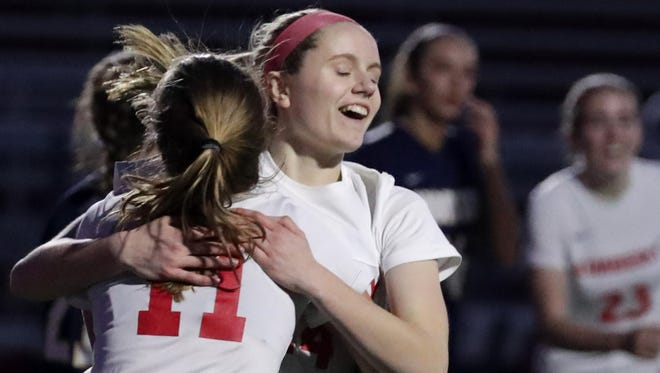 Kimberly's Katie Behnke (14) hugs Delaney Schultz (11) following Behnke's second-half goal against Appleton North High School during their girls soccer game on Monday, April 23, 2018 in Kimberly, Wis.