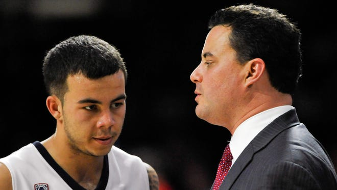 Arizona head coach Sean Miller talks to guard Gabe York on Nov 9, 2014 in the game against Cal Poly Pomona at McKale Center in Tucson.