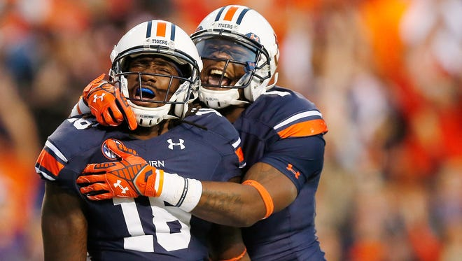 Auburn wide receiver Sammie Coates (18) celebrates a touchdown reception with wide receiver D'haquille Williams on Oct. 4, 2014, in Auburn, Ala.