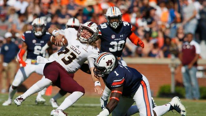 Auburn defensive tackle Montravius Adams (1) tackles ULM quarterback Garrett Smith (13) during the second quarter at Jordan Hare Stadium.