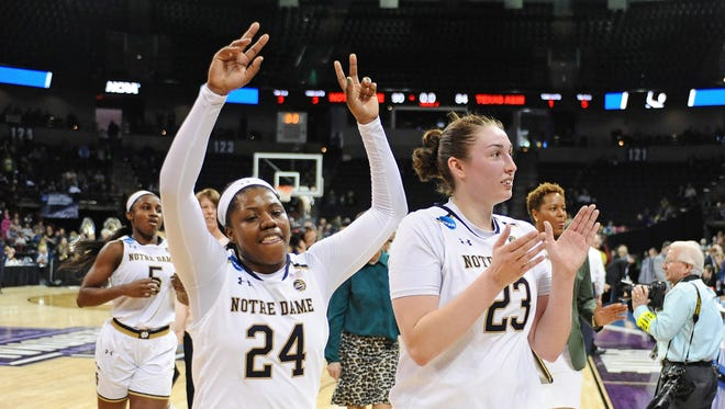 Notre Dame guard Arike Ogunbowale (24) and forward Jessica Shepard celebrate after a game against Texas A&M in the semifinals of the Spokane Regional.
