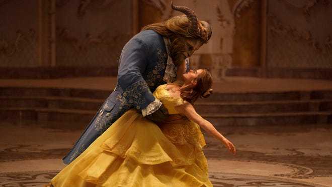 """This image released by Disney shows Dan Stevens as The Beast, left, and Emma Watson as Belle in a live-action adaptation of the animated classic """"Beauty and the Beast."""""""