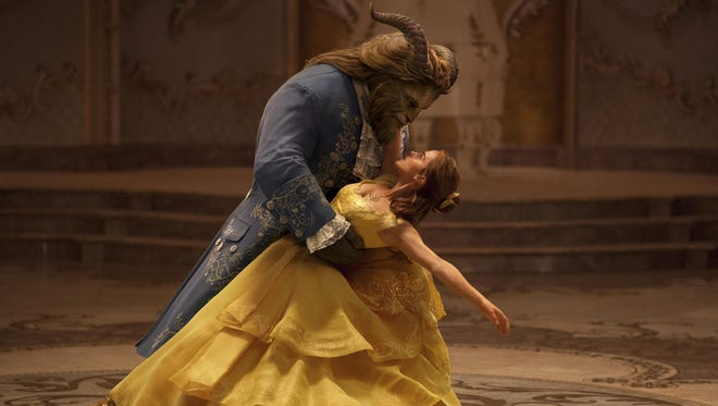 """Dan Stevens as The Beast (left) and Emma Watson as Belle in a live-action adaptation of the animated classic """"Beauty and the Beast."""""""