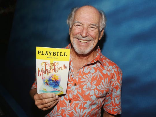 "Jimmy Buffett holds a Playbill for his new musical ""Escape to Margaritaville,"" which opened on Broadway Thursday."