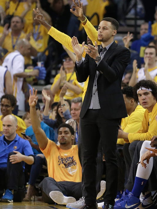 Golden State Warriors' Stephen Curry cheers from the bench during the first half in Game 2 of a first-round NBA basketball playoff series against the Houston Rockets Monday, April 18, 2016, in Oakland, Calif. (AP Photo/Ben Margot)