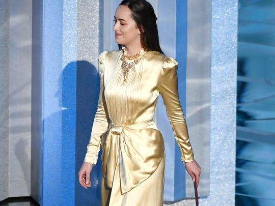 Actor Dakota Johnson walks onstage during the 89th