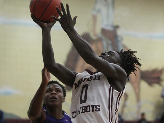 Madison County's Travis Jay goes up for a layup in