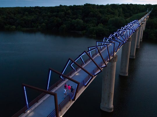 The High Trestle Bridge is seen from the air as flood waters continue to swell the Des Moines River below on Thursday, July 5, 2018, in Madrid.