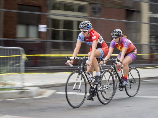 Cyclists bike around downtown Muncie during one of