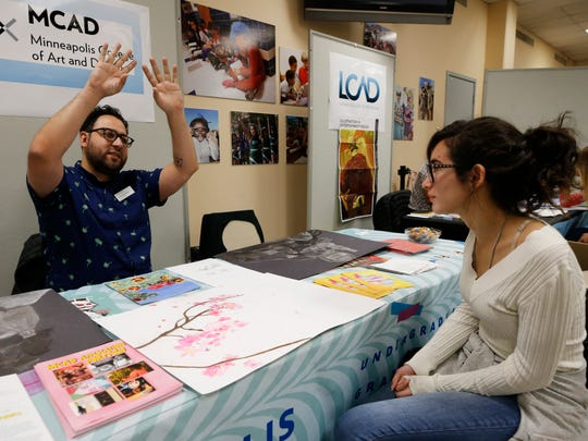 Austin High School student Ashley Leweini, 15, shows her artwork to Christopher Alday, an administrative counselor for the Minneapolis College of Art and Design, during the EPISD Fine Arts Departments Visual Arts College Fair. Leweini was among the students who attended the fair to receive critiques and advice from representatives from art schools who were at the event to recruit students, as well as to provide feedback on how students can improve their work as they follow their dreams of becoming artists.