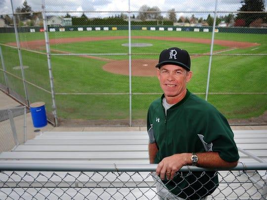 Regis head baseball coach Don Heuberger stands before