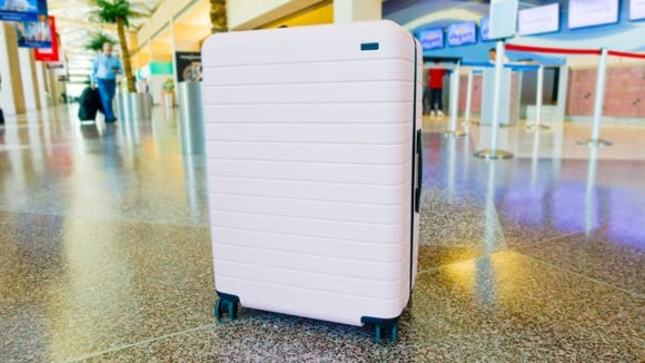 End of the year travel requires a stylish piece of luggage.