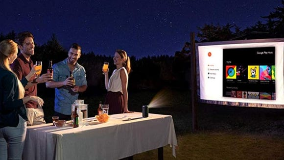 Pick up a smart mini projector to stream holiday movies during your party.