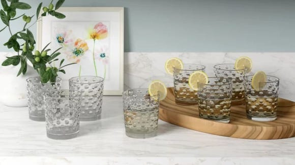 These chic drinking glasses come in two sizes—a cooler glass and a rocks glass.
