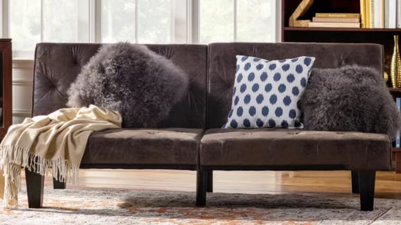 This rustic sofa makes a great addition to any living area.