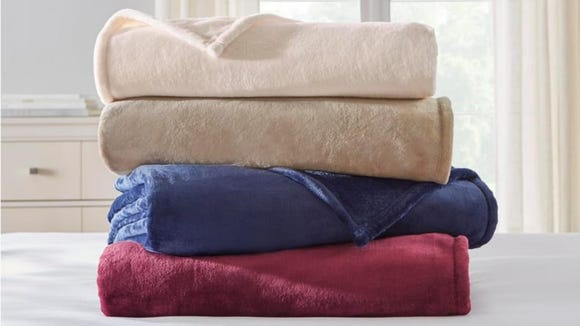 This cozy fleece blanket is perfect for draping over chairs and cuddling in front of the TV.