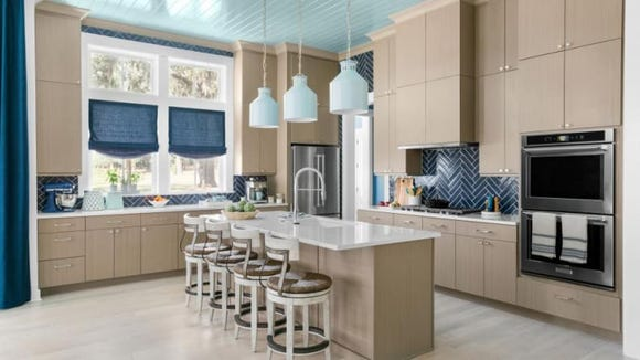 The contrasting costal colors of this kitchen is to die for.