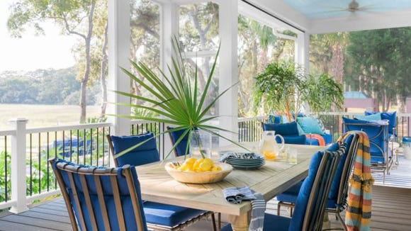 The blue accents continue into the outdoor dining room.