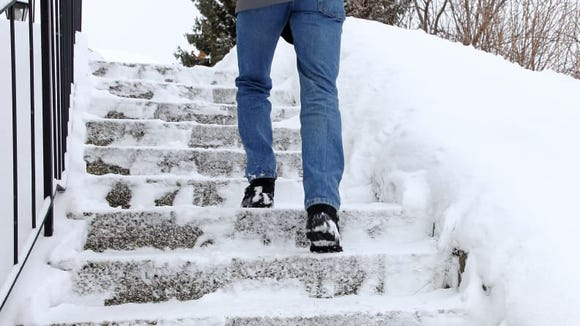 Having a handrail in a sloped, icy spot can make a big difference in overall safety.