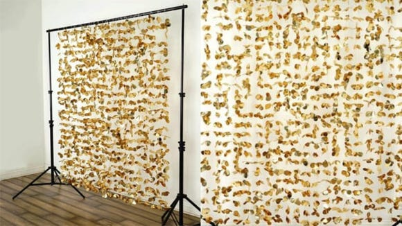 Take paparazzi photos of your friends' red carpet looks with this dazzling backdrop that's as gold as those little statues.