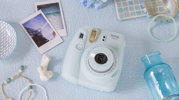 The Fujifilm Instax Mini 9 comes in six different shades, including this one that's as green as Amy March's beloved pickled limes.