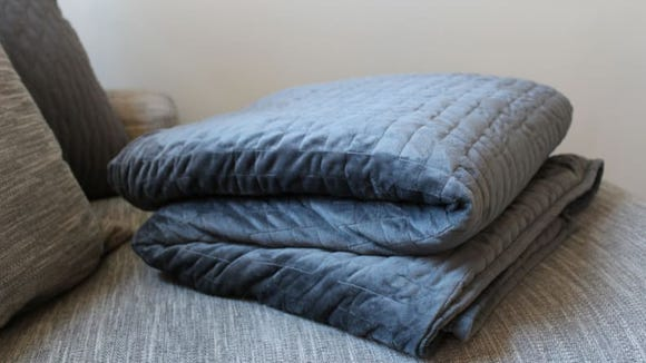 Cozy up with the Gravity Blanket to calm yourself down or fall asleep.