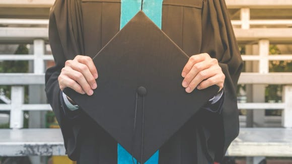 Even if walking across the stage isn't an option, you can still  get a cap and gown.
