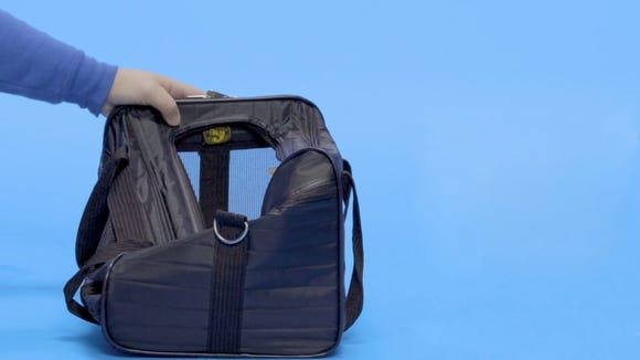Your kitty can travel in first class with this faux lamb skin lined carrier