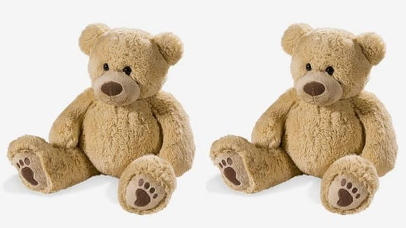 Tucking this cute bear under your arm can actually help you stay in a more comfortable and spine-friendly sleeping position
