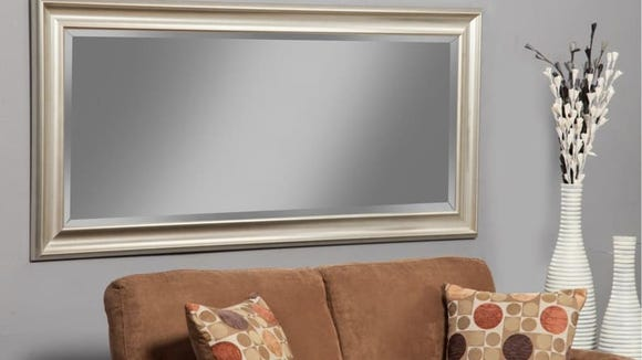 Bring light and space into your home with this generous mirror