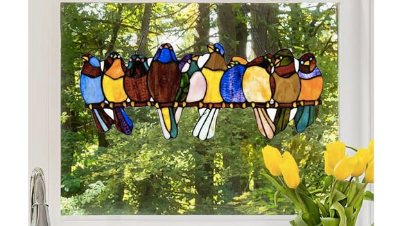 Although you can hang this stained glass anywhere, put it against a bright window for the full effect