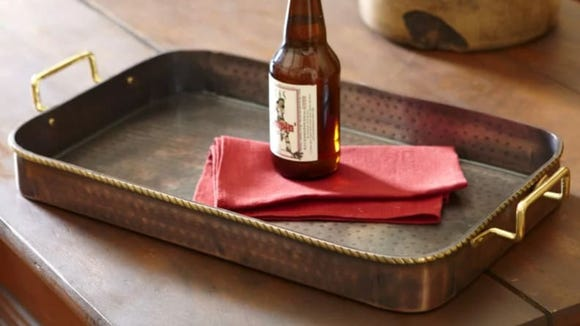 This copper tray looks equally good on your dining table as it does on your coffee table.