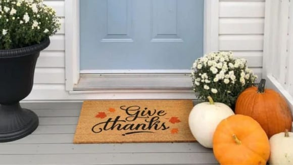 Greet your holiday guests with this happy welcome mat.