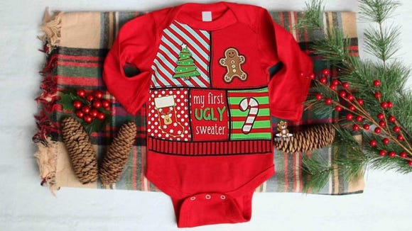 Put your cute baby in their first ugly holiday sweater.