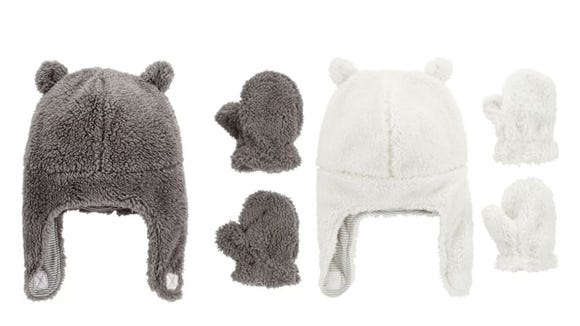 Reviewers say these hats and mittens fit snugly on little heads and hands.