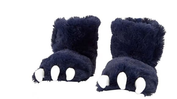 These fluffy slippers cover feet and ankles for maximum coziness.