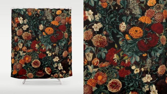 Vibrant and contrasting shades add drama to this floral shower curtain.