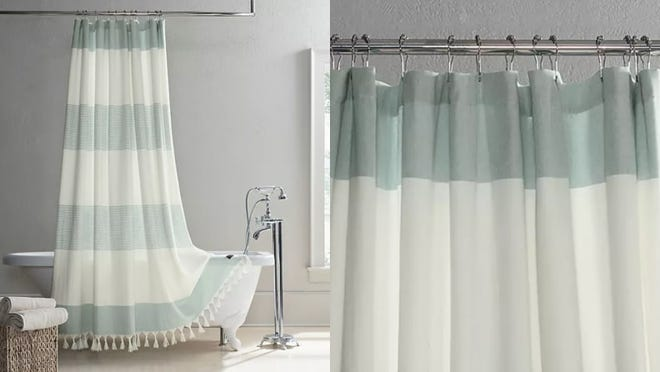 This green and white shower curtain is a subtle but tasteful addition to a bathroom.