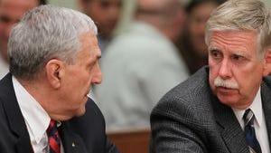 Attorney John Parrinello (l) with former Greece Police Chief Merritt Rahn at Rahn's criminal trial.