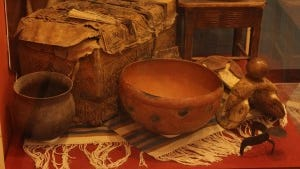 The exhibit is filled with artifacts of the five cultures including Mimbres pottery, Apache baskets, Spanish and Mexican household and trail items, religious objects, and beautifully woven items of clothing with some dated to early 19th century Nuevo Mexico.