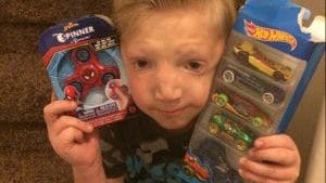 Jackson Bezzant with gifts from neighbors who heard about the bullying he faced in school.