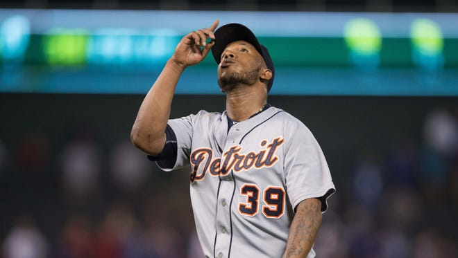 Tigers pitcher Neftali Feliz celebrates getting the save in the win over the Rangers Monday in Arlington, Texas.